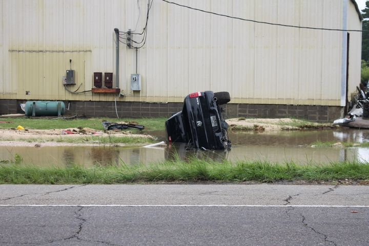 An overturned truck in the floodwaters in Amite, Louisiana.