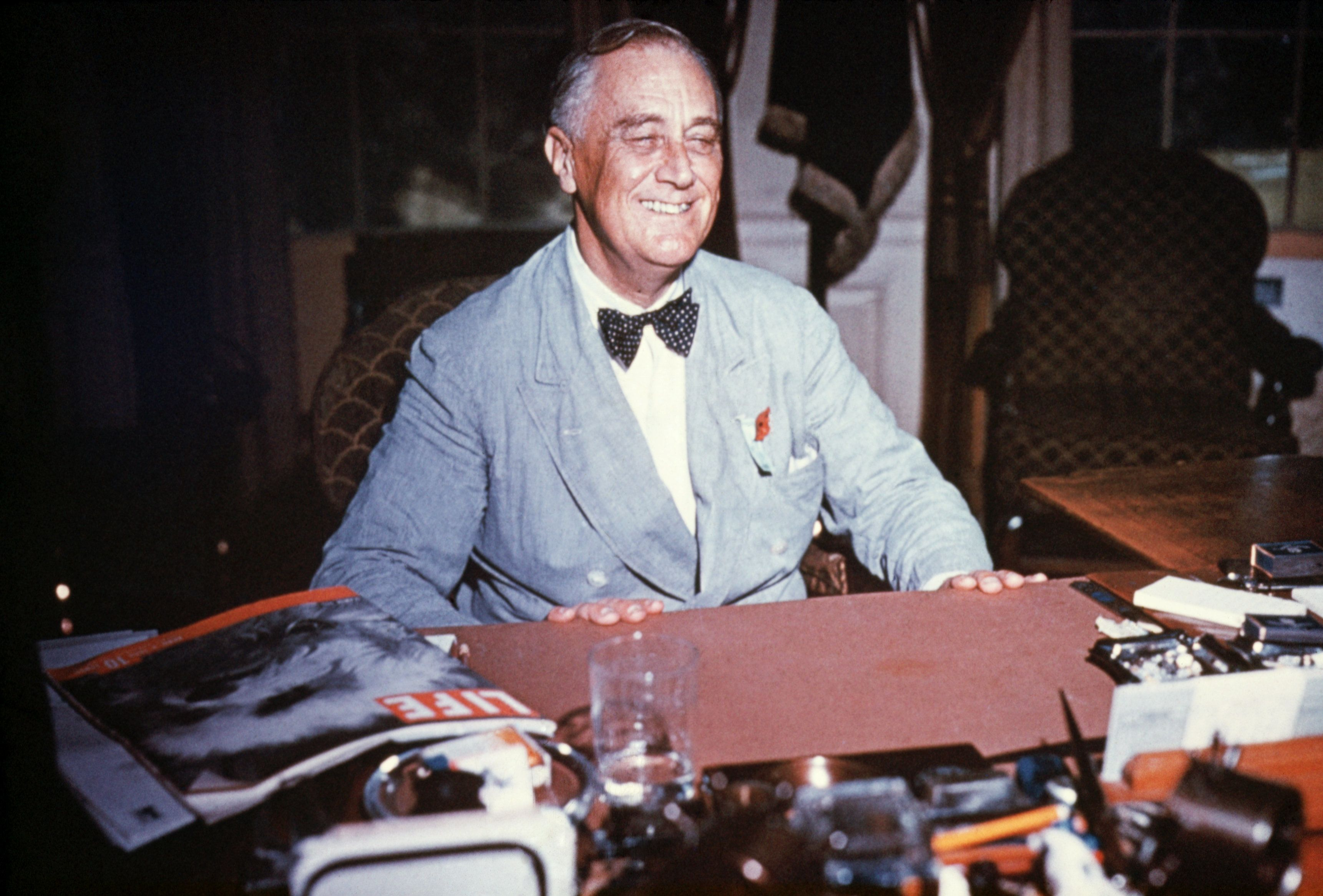 (Original Caption) Portrait of Franklin Delano Roosevelt seated at his desk, smiling. Undated color slide.