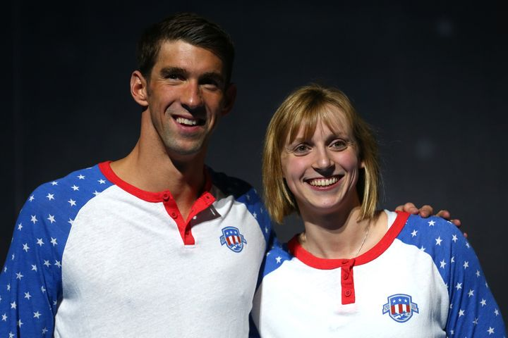Michael Phelps and Katie Ledecky celebrate at the Olympic swimming trials in July. She once stood in line to get an autograph