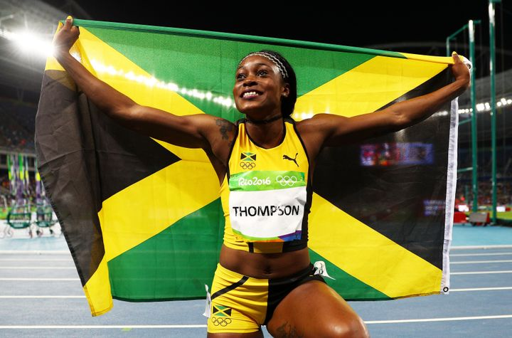 Elaine Thompson of Jamaica celebrates after winning the Women's 100m final.