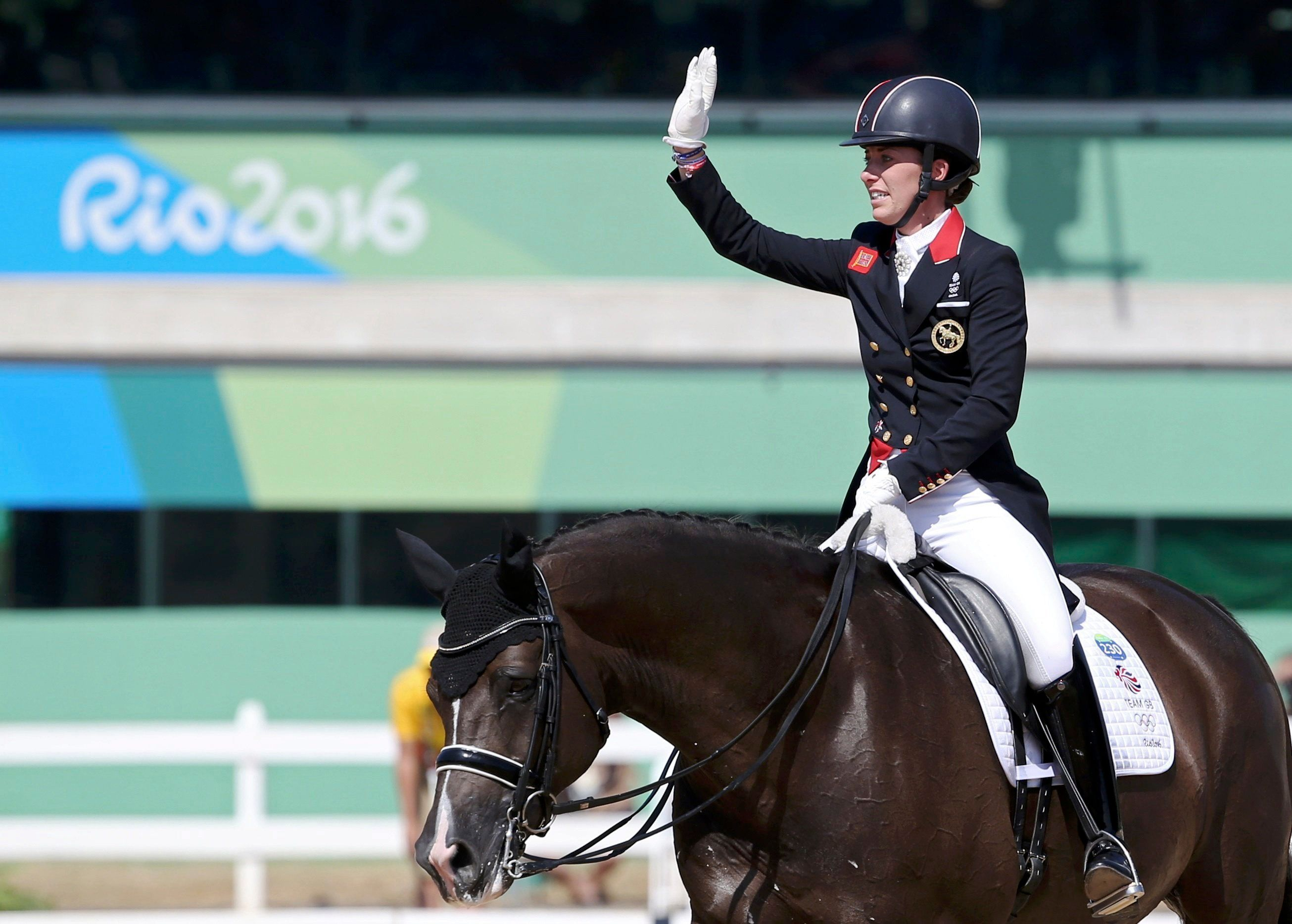 Charlotte Dujardin during her gold-winning performance (above and