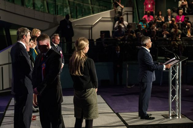 Paul Golding, turns his back Sadiq Khan of the Labour Party makes an acceptance speech as the new Mayor...