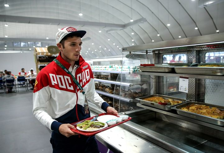 RIO DE JANEIRO, BRAZIL AUGUST 2, 2016: Russian boxer Andrei Zamkovoi having lunch in the canteen in the Olympic village ahead