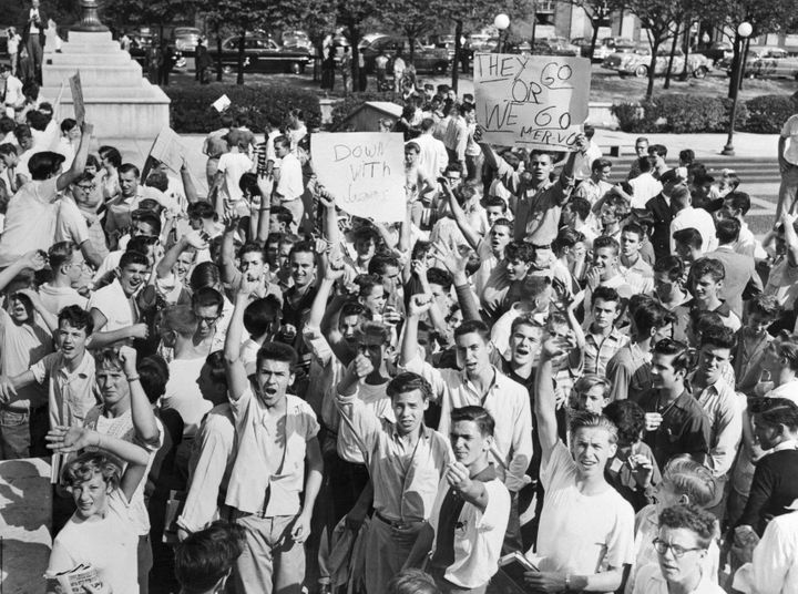 White high school students gather in front of Baltimore City Hall in October 1954, demanding that black students be barr