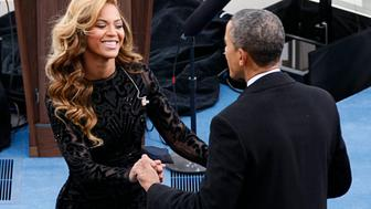 Singer  Beyonce is greeted by U.S. President Barack Obama after her performance during inauguration ceremonies in Washington, January 21, 2013.  REUTERS/Rick Wilking (UNITED STATES  - Tags: POLITICS ENTERTAINMENT)