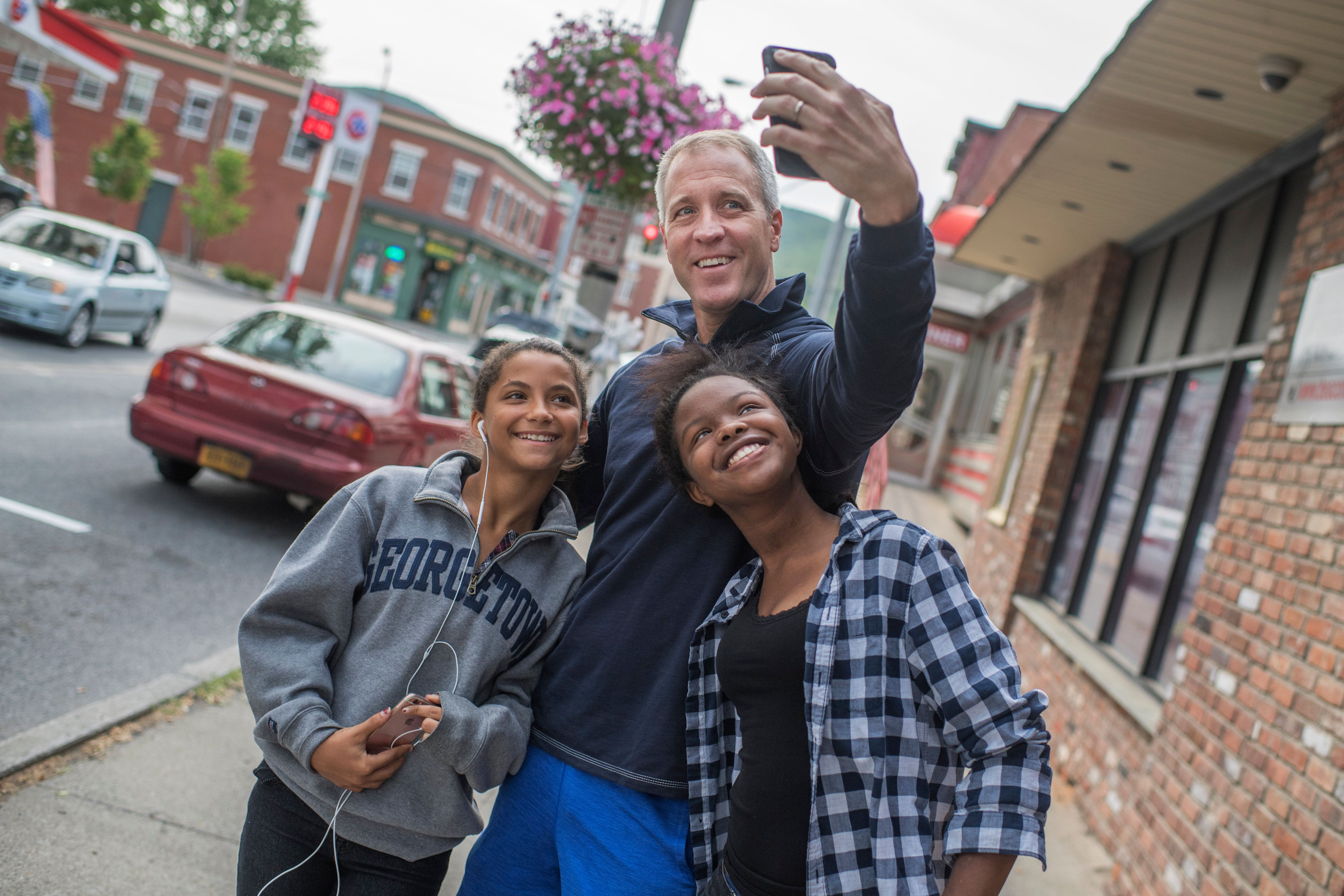 UNITED STATES - JUNE 11: Rep. Sean Patrick Maloney, D-N.Y., makes a snapchat with with his daughters Daley, 15, right, and Essie, 13, outside of the Yankee Clipper Diner in Beacon, N.Y., June 11, 2016. (Photo By Tom Williams/CQ Roll Call)