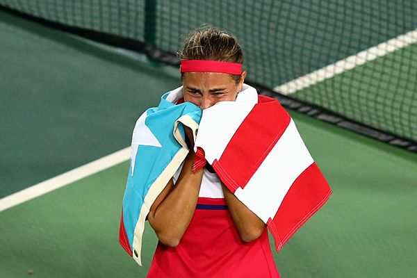 "<a href=""http://www.wtatennis.com/news/article/5804369/title/puig-wins-historic-gold-for-puerto-rico"" target=""_blank"">Monica"