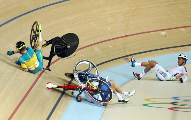 Glenn O'Shea of Australia, Elia Viviani of Italy and Park Sanghoon in the aftermath of