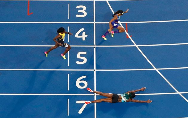 Felix, in lane four, crosses the finish line just behind Shaunae Miller of the Bahamas, who dove...