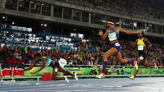 RIO DE JANEIRO, BRAZIL - AUGUST 15:  Shaunae Miller of the Bahamas (L) dives over the finish line to win the gold medal in the Women's 400m Final ahead of silver medalist Allyson Felix of the United States (C) and bronze medalist Shericka Jackson of Jamaica (R) on Day 10 of the Rio 2016 Olympic Games at the Olympic Stadium on August 15, 2016 in Rio de Janeiro, Brazil.  (Photo by Alexander Hassenstein/Getty Images)