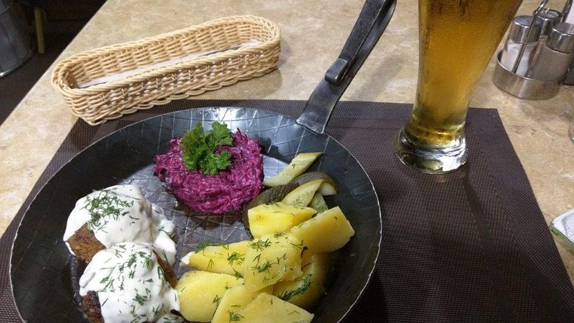 Meal of Konigsberg Klops meatballs, beet salad and potatoes costs under $7