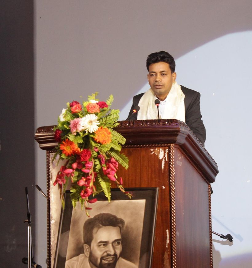 Raksha Ram Chamar presenting acceptance remarks at the award ceremony.Below: A portrait of Suvash Darnal