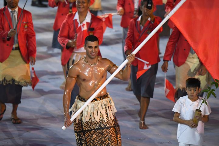 Tonga's flagbearer Pita Nikolas Taufatofua leads his delegation during the opening ceremony of the Rio 2016 Olympic Games at
