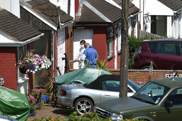 Forensic officers at an address on the street where Dalian Atkinson was tasered by