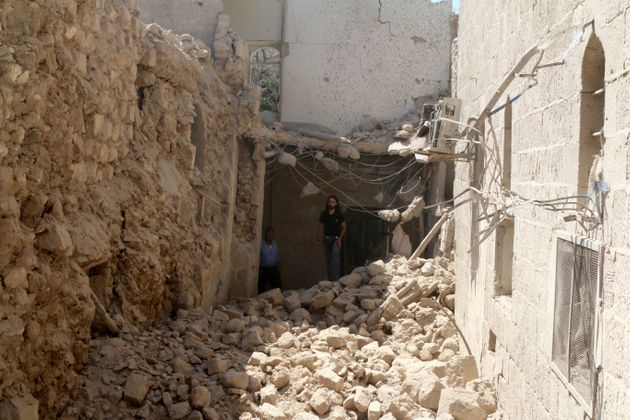 Residents inspect their damaged homes after an airstrike on the rebel-held Old Aleppo, Syria August 15,
