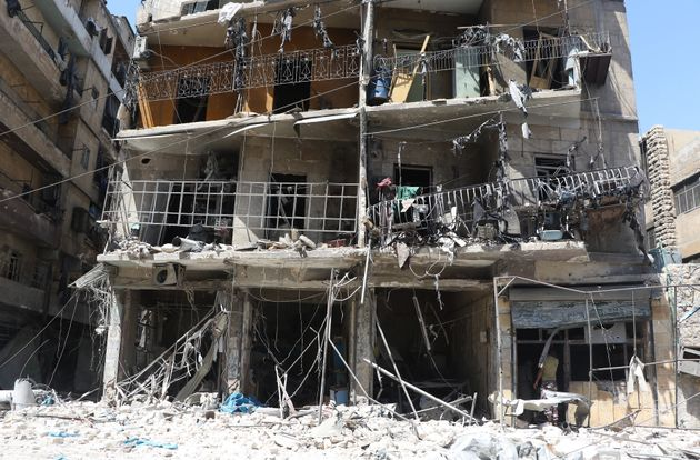 Debris of a building is seen after warcrafts belonging to Syrian and Russian army hit the residential...