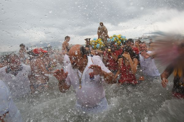 Worshippers splash water ateach other to celebrate the arrival of the Virgin of Palm.