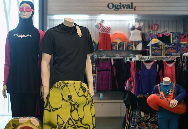 A burkini is sold alongside other swimwear at a shopping mall in Kuala Lumpur.