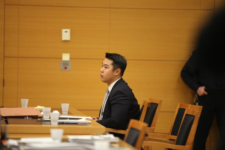 New York City police officer Peter Liang sits in court as testimony is read back for jurors during deliberations in his trial
