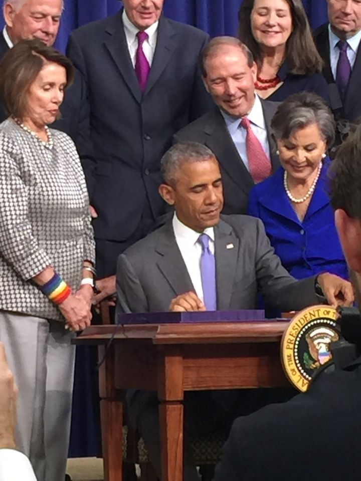 President Obama signing Trevor's Law into action.