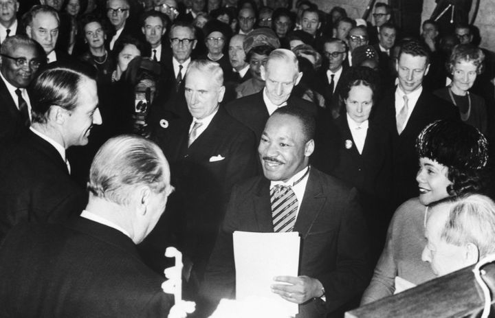 Crown Prince Harald and King Olav of Norway congratulate American civil rights activist Martin Luther King Jr. after he recei
