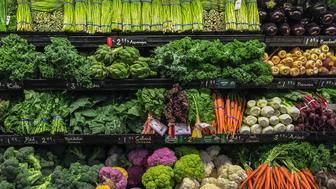 View of well ordered vegetables for sale in a supermarket