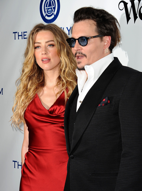 Amber Heard And Johnny Depp Reach Divorce