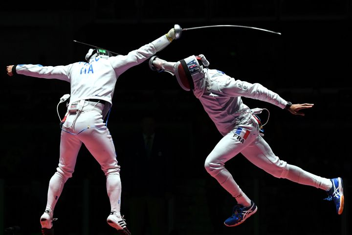 Italy's Paolo Pizzo, left, competes against France's Yannick Borel atthe Rio Olympicson August 14, 2016.