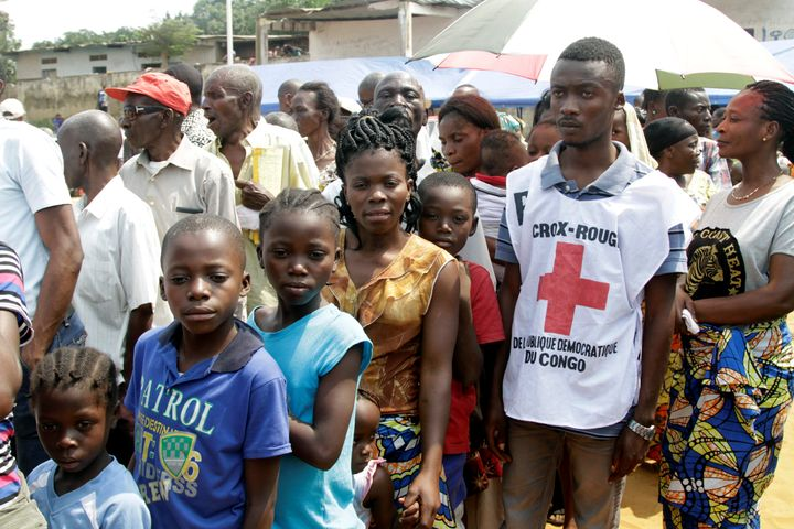 Congolese civilians queue at a soccer pitch to be vaccinated during an emergency campaign of vaccination against yellow fever