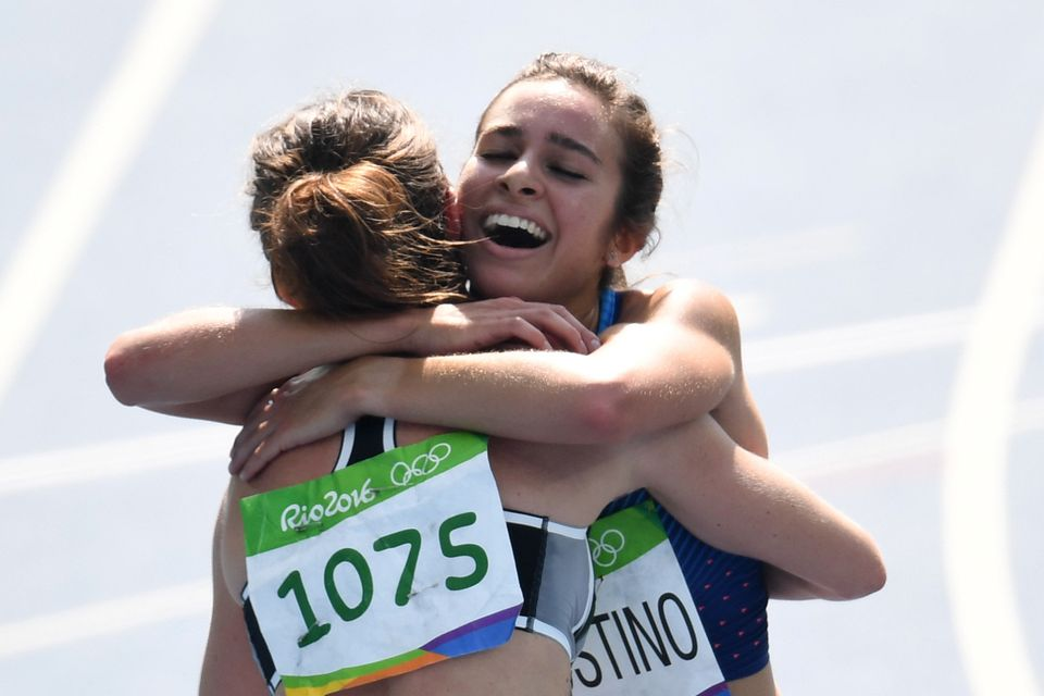 New Zealand's Nikki Hamblin (L) hugs USA's Abbey D'agostino after they competed in the Women's 5000m Round 1 during the athle
