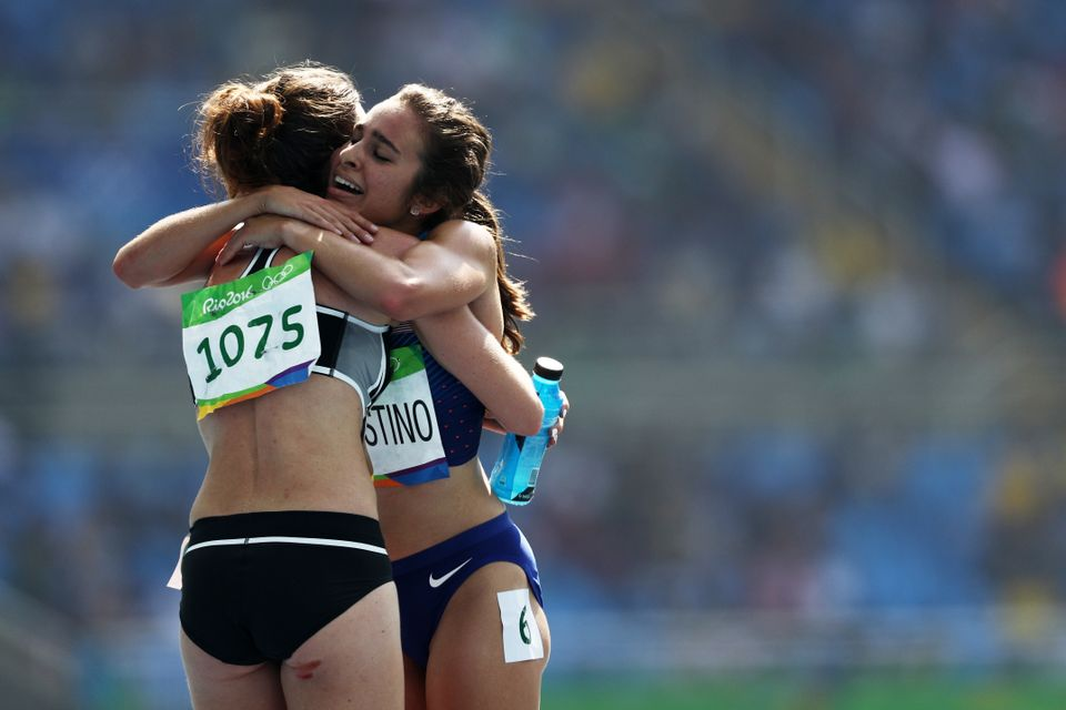 Abbey D'Agostino hugs Nikki Hamblin after Round 1 of the women's 5000-meter in Rio de Janeiro,