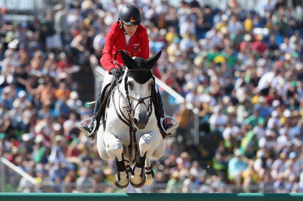 Germany's Meredith Michaels-Beerbaum, riding Fibonacci, competes inindividual jumping.