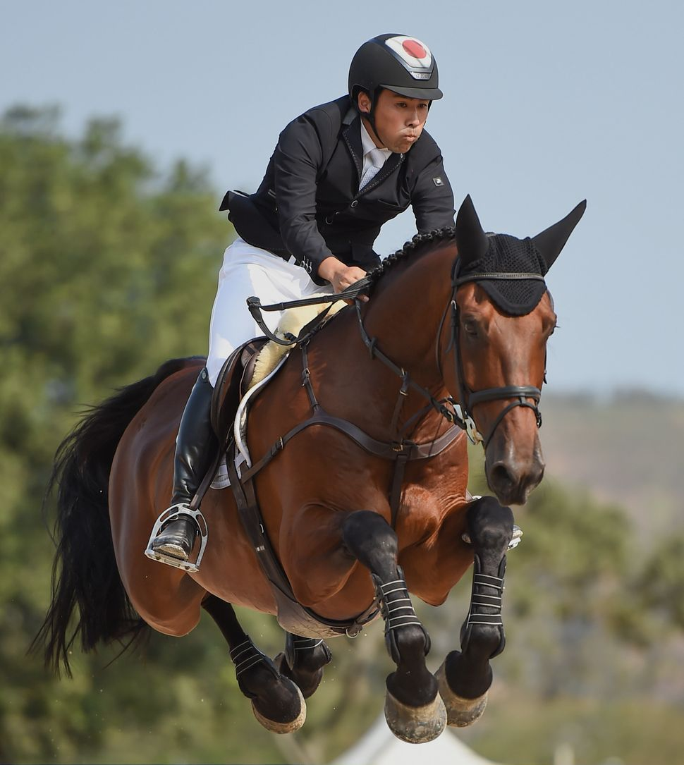 Japan's Yoshiaki Oiwa andThe Duke of Cavan in action during the eventing individual jumping final at the Rio Games.