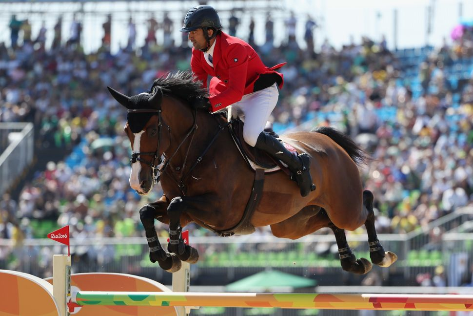 Karim El Zoghby of Egypt, riding Amelia, competes during the jumping individual and team qualifier.