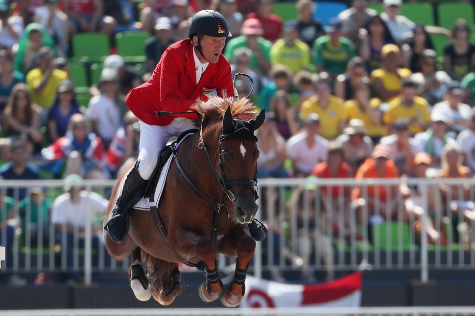 Germany's Ludger Beerbaum rides Casello during the jumping individual and team qualifier.