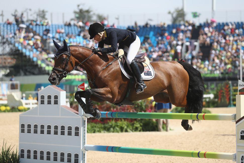 Edwina Tops-Alexander of Australia rides Lintea Tequila during team jumping.