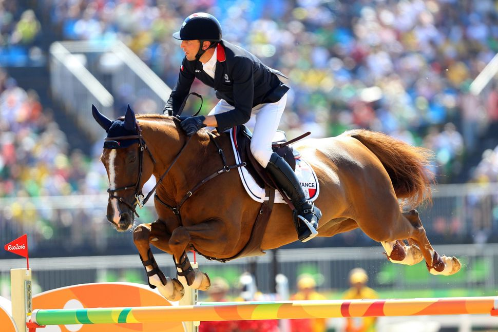 Kevin Staut of FranceonReveur de Hurtebise inthe jumping individual and team qualifier.
