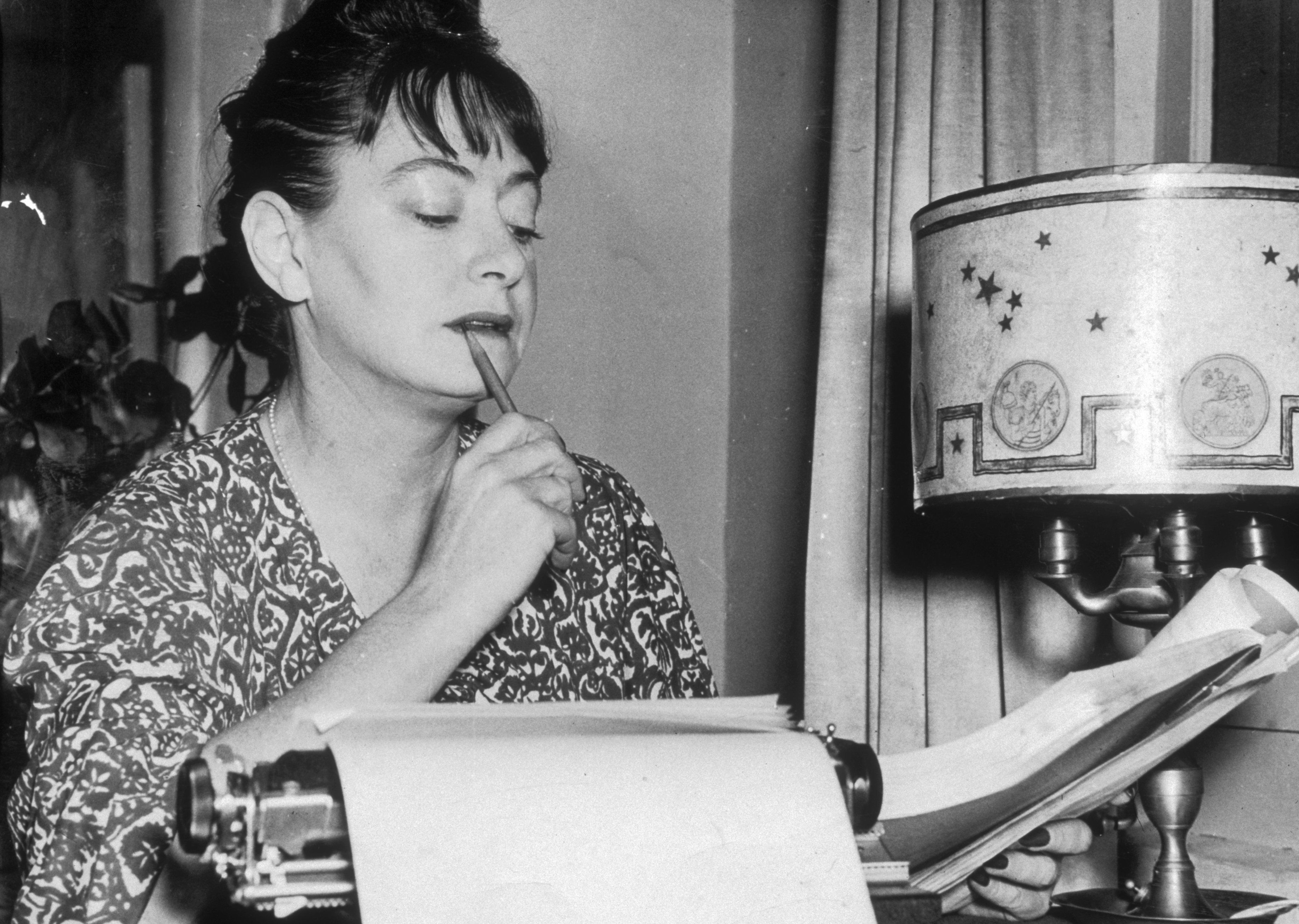circa 1948:  American writer Dorothy Parker (1893 - 1967) reviews a draft copy of a manuscript at her home.  (Photo by New York Times Co./Getty Images)