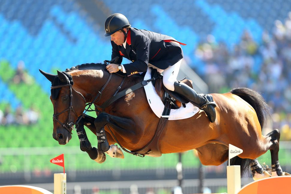 Great Britain's Nick Skelton, on Big Star, inthe jumping individual and team qualifier.