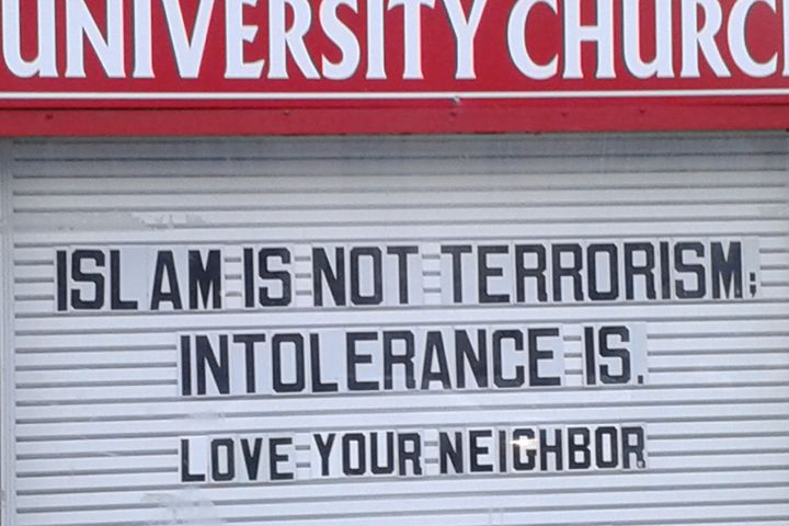 Sign outside of a church in Hyde Park, Chicago, following the November 13, 2015 Paris attacks claimed by ISIS.