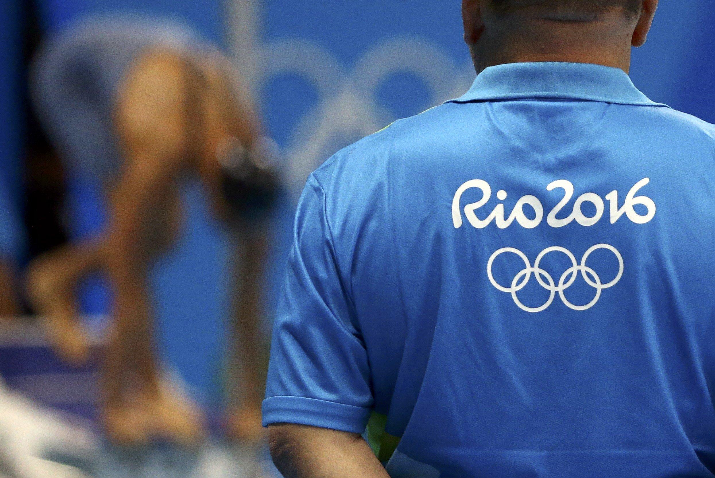 An unidentified Rio Olympics volunteer looks on at the aquatics center last week.