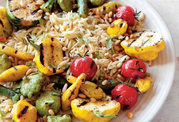 If you're cooking dinner outside over the coals, odds are this orzo salad will complement your main course nicely. It include