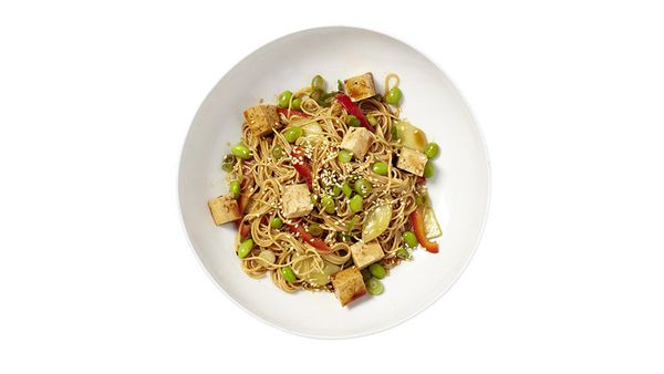 A tangle of angel-hair pasta; thin strips of sweet red bell pepper; half-moons of refreshing cucumber; and, bright green, cri