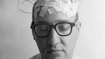 1960s PORTRAIT OF MAN CHARACTER WITH WIRES TAPED TO BALD HEAD  (Photo by H. Armstrong Roberts/ClassicStock/Getty Images)