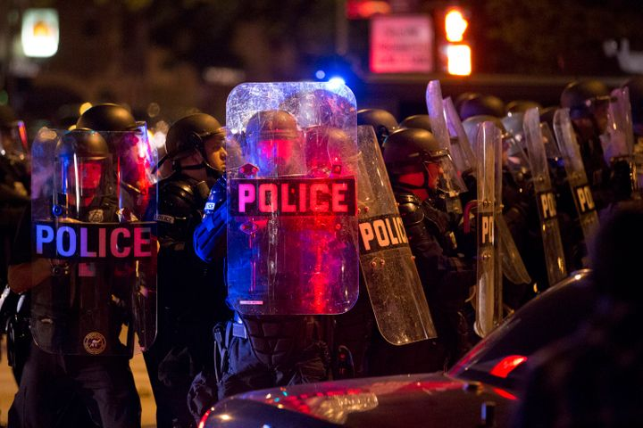 Police respond to a protest after rioters threw rocks and bottles in the unrest following a fatal police shooting in Milwauke
