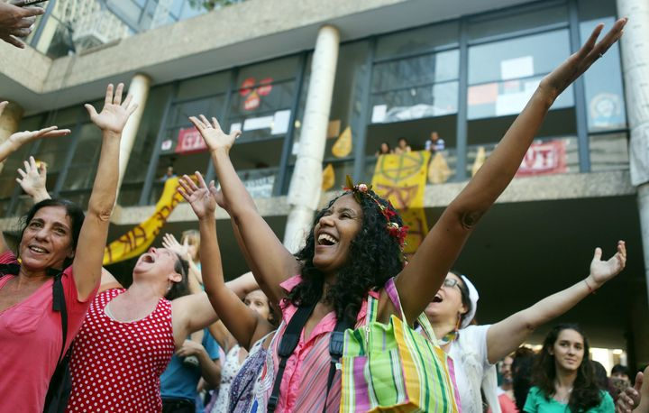 Artists dance during a protest against Temer in front of Capanemain Rio de Janeiroon May 22.