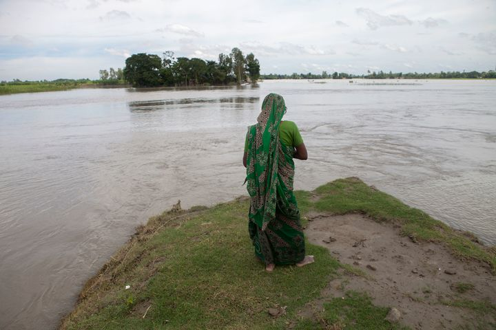 A flood affected woman stands on a highland at Guthail, Jamalpur earlier this month. According to the Bangladesh Disaster Man