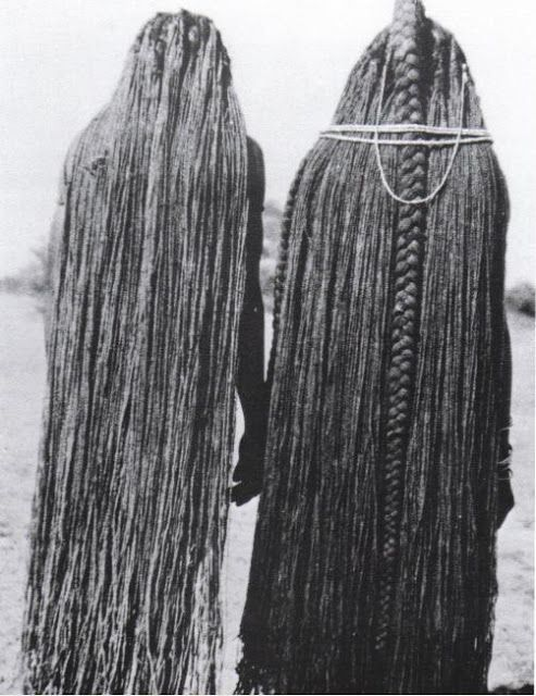 Traditional African Hair Extensions. The hair on these women has been lengthened to their ankles using sinew extensions, Mbal
