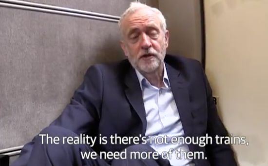 Jeremy Corbyn on the floor of a crowded