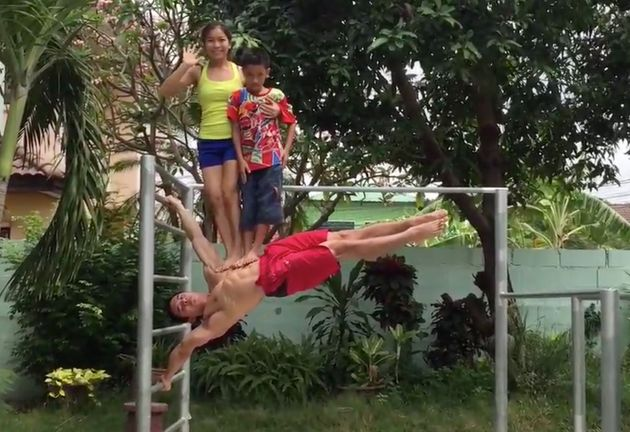Incredible Moment Fitness Fanatic Holds Flagpole Pose With Two Children Stood On His